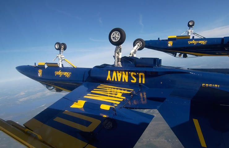 blue angel flying inverted