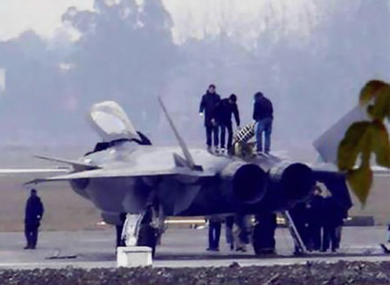 crew work on the new j20 chengdu stealth jet