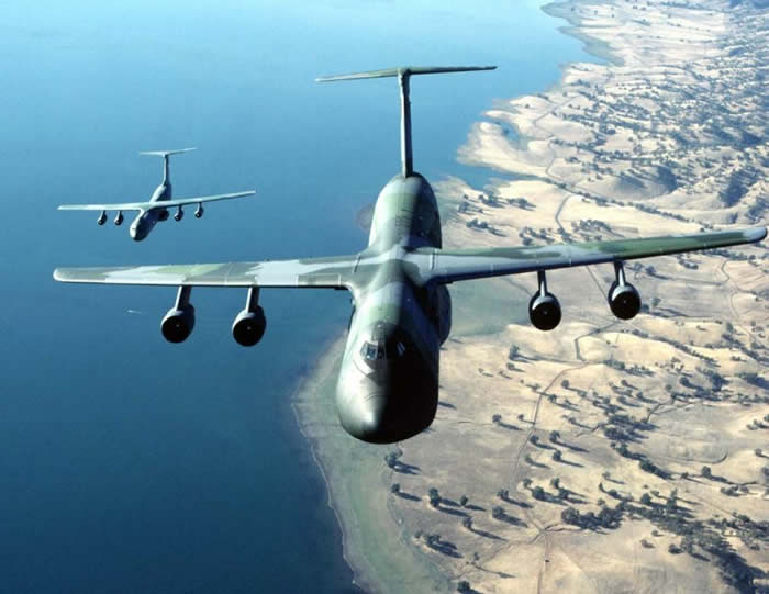 c5 flying with c141 cargo military aircraft