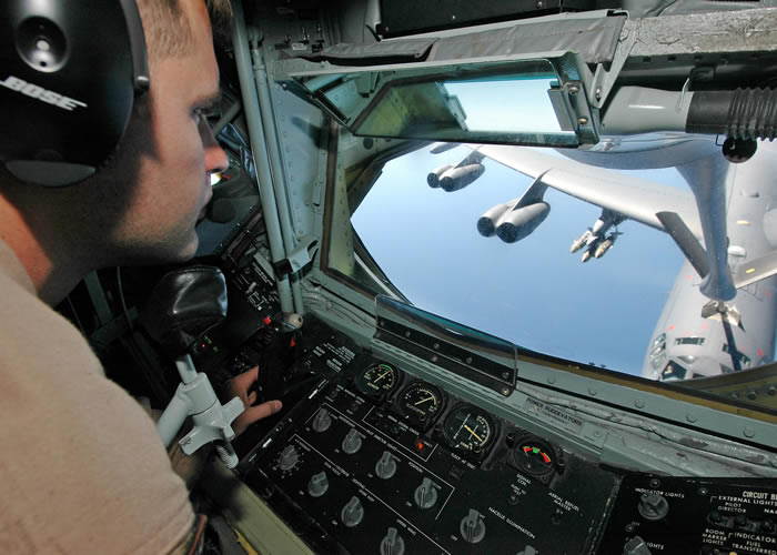 Boom operator of kc-135 refuels a b-52 in the air