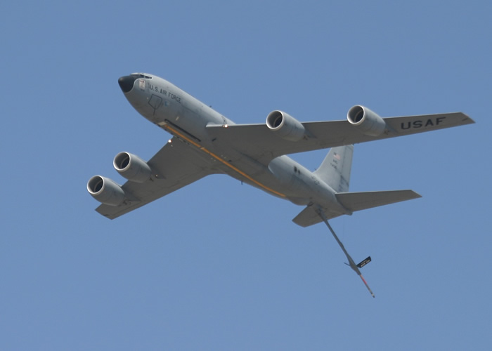 kc-135 in flight with boom extended
