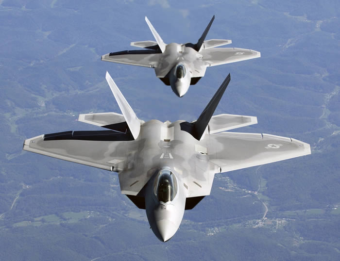f22 raptors flying in column