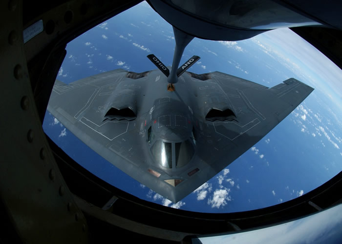 B-2 USAF Stealth Bomber Being Refueled over Ocean By A KC-135