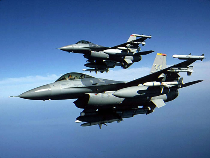 F-16 Fighter Aircraft In Flight. Background The F-16A, a single-seat model,