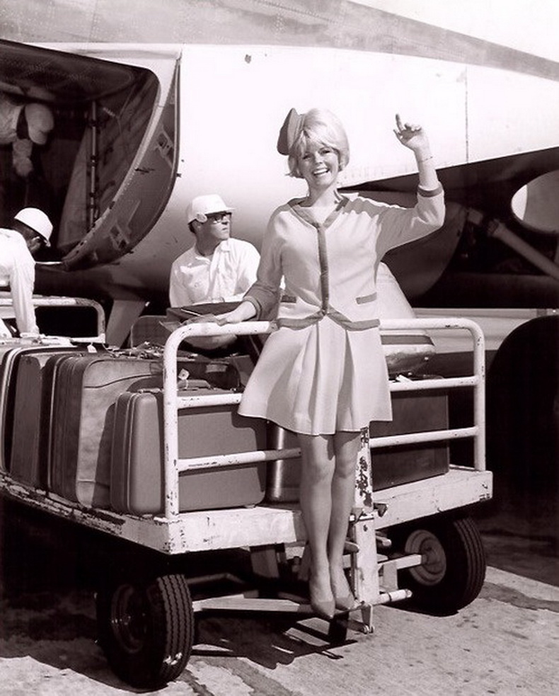 flight attendant on baggage cart