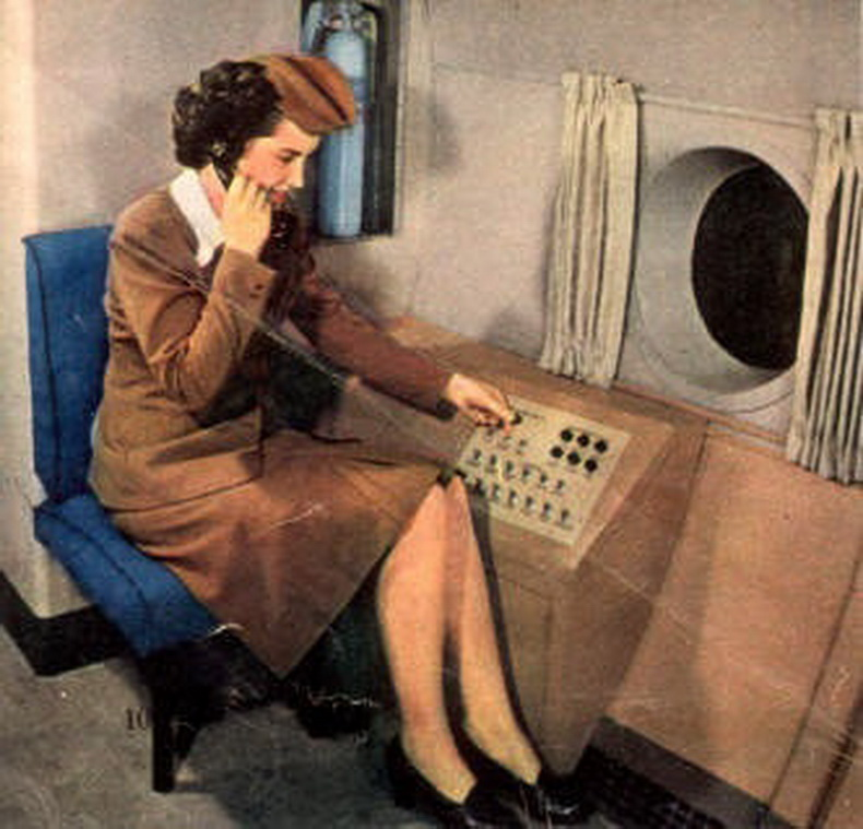 flight attendant using intercom in flight
