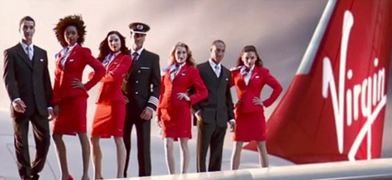 flight attendants from virgin airlines on aircraft wing