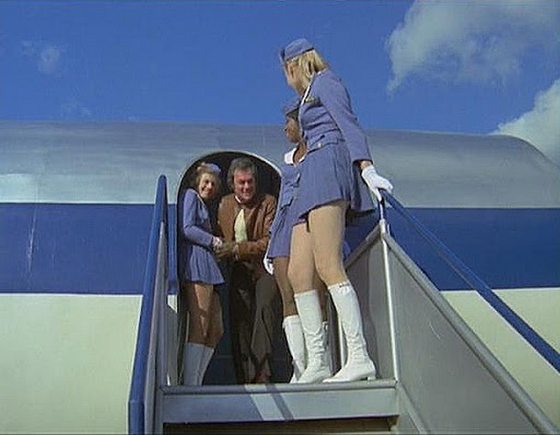 flight attendants wearing white go go boots
