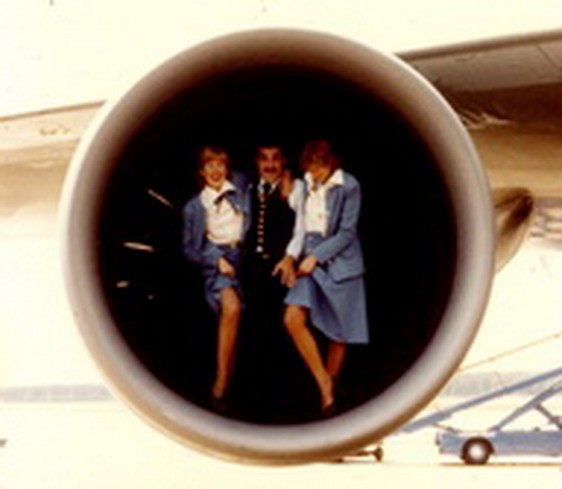 flight attendants and pilot in aircraft engine