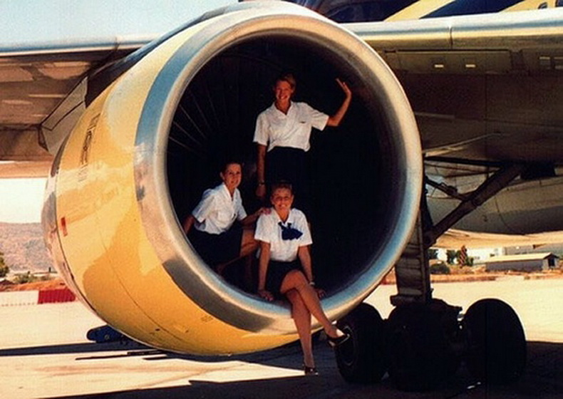 flight attendants in rolls royce aircraft engine