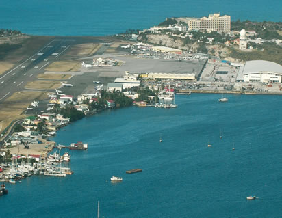 runway and terminal at princess juliana airport